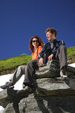 Happy man and woman in mountains Stock Images