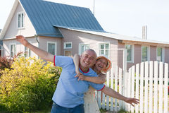 Happy man and woman near gate of  home Stock Photography