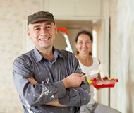 Happy man and woman paints wall at home Stock Photo