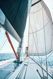 Happy man and woman relaxing on a luxury yacht. lovers on cruise royalty free stock photo