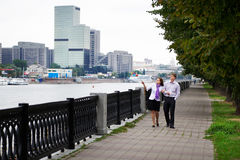 Happy man and woman at romantic walk on embankment Stock Photos