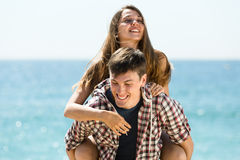Happy man and woman on sea background Royalty Free Stock Image
