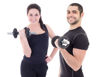 Happy man and woman in sportswear doing exercises with dumbbells Royalty Free Stock Photography