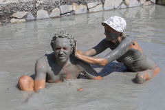 Happy man and woman taking a mud bath. Dalyan, Turkey Royalty Free Stock Photography