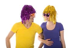 Happy man and woman with wigs and sunglasses Stock Photo