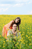 Happy man and woman in yellow meadow Royalty Free Stock Image