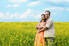 Happy man and woman in yellow meadow Stock Photo