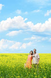 Happy man and woman in yellow meadow Royalty Free Stock Images