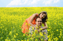 Happy man and woman in yellow meadow Stock Photos