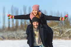 Happy man and woman. Young Couple On Winter Vacation Stock Images