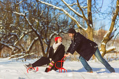 Happy man and woman. Young Couple On Winter Vacation Stock Photo