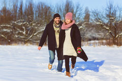 Happy man and woman. Young Couple On Winter Vacation Stock Image