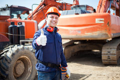 Happy man at work in a construction site Royalty Free Stock Image