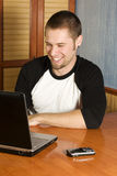 Happy man working on computer. From home Stock Image