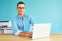 Happy man working on computer Royalty Free Stock Photos