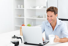Happy man working on his laptop Stock Image