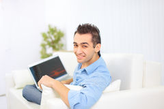 Happy man working on his laptop Royalty Free Stock Images