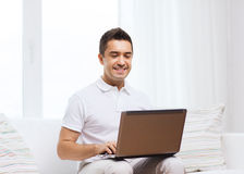 Happy man working with laptop computer at home Stock Photography