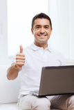 Happy man working with laptop computer at home Royalty Free Stock Photography