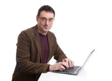 Happy man working on laptop Royalty Free Stock Photos