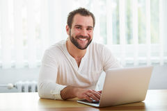 Happy man working with laptop Stock Photo