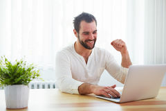Happy man working with laptop Royalty Free Stock Photo