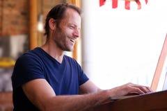 Happy man working on laptop. Portrait of happy man working on laptop royalty free stock photos