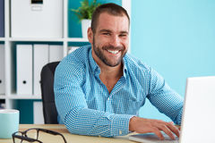 Happy man working in office Stock Photos