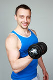 Happy man working out with dumbbells Royalty Free Stock Photos