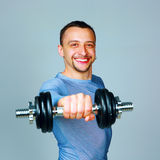 Happy man working out with dumbbells Royalty Free Stock Photography