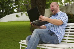 Happy Man Working in a Park Stock Image