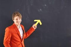Happy man with a yellow arrow Stock Photo