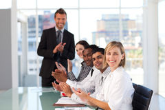 Happy manager clapping in a presentation royalty free stock photography