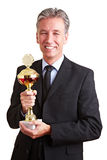 Happy manager holding trophy Stock Photo