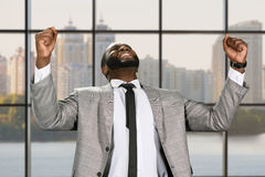 Happy manager in the office. The businessman's victory. Happy manager in the office. Black man celebrating sucess. Business success in the capital Stock Images