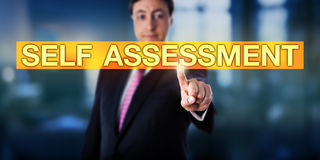 Happy Manager Pressing SELF ASSESSMENT. On a touch screen interface. Business metaphor and applied psychological concept for self-assessment or self-evaluation royalty free stock image