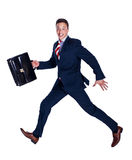 Happy manager running. With a briefcase Royalty Free Stock Image