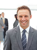 Happy manager standing in front of his team Royalty Free Stock Photography