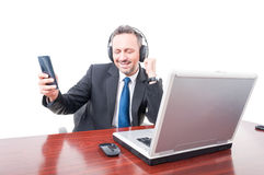 Happy manager taking break and listening music Royalty Free Stock Photography