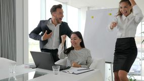 Happy managers jump, young successful people, successful deal business team in modern office, emotional employees stock video