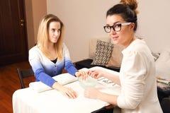 Happy manicurist in salon Stock Images