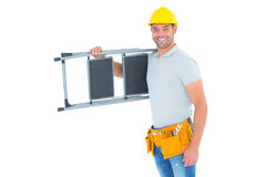 Happy manual worker carrying step ladder Royalty Free Stock Photos