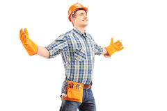 Happy manual worker with helmet spreading arms Royalty Free Stock Photography
