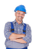 Happy Manual Worker Standing Arms Crossed. Portrait of happy manual worker standing arms crossed over white background Royalty Free Stock Photography