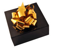 Happy many returns of the day. Golden bow on a black box isolated on white background Royalty Free Stock Image