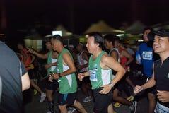 Happy Marathon Runner. Kuala Lumpur, June 26 : Standard Chartered KL Marathon 2011 is International marathon event held in Kuala Lumpur, Malaysia on June 26 Royalty Free Stock Photos