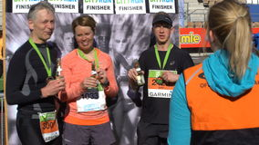 Happy marathon runners are making a photograph after the race. stock footage
