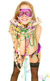 Happy Mardi Gras Girl. Young and beautiful caucasian in colorful mardi gras dress wearing a lot of beads