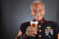 Happy Marine Celebrating. An elderly Marine holds a beer stock photo