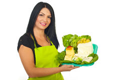 Happy market worker holding cheese Stock Photo